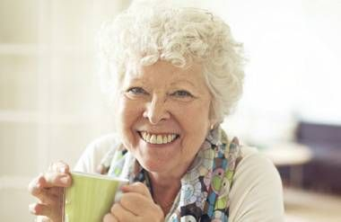 Woman having coffee at home
