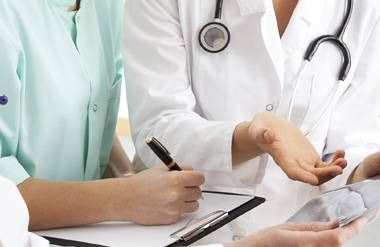 Doctors reviewing medical records