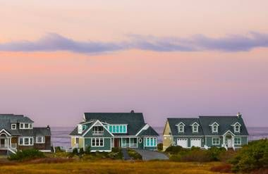 Vacation homes on water at sunset