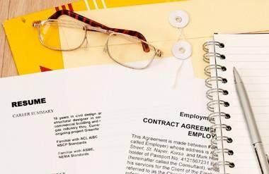 Resume, job offer, notebook, glasses