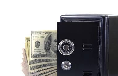 Money coming out of a safe