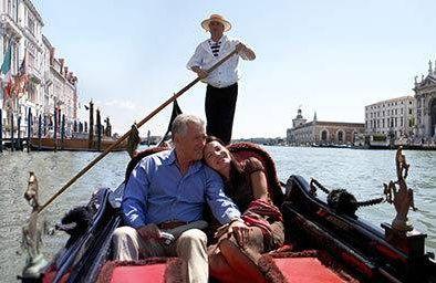 Couple riding gondola in Italy