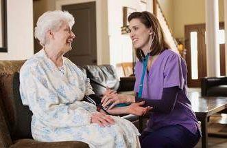 a home care nurse with a patient