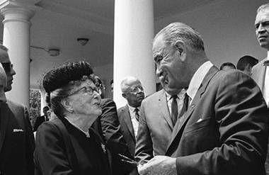 President Lyndon Johnson and woman shake hands