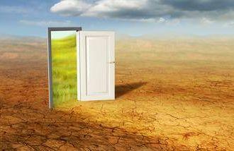 A magical door opening in the desert.