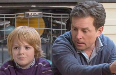 "Jack Gore as Graham Henry (left) and Michael J. Fox as Mike Henry in ""The Michae"