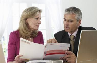 Woman and man reviewing financial information