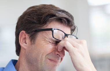 Man wincing with stress