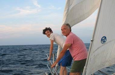Ed Merck and his son sailing