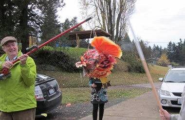 Family hitting pinata on Thanksgiving