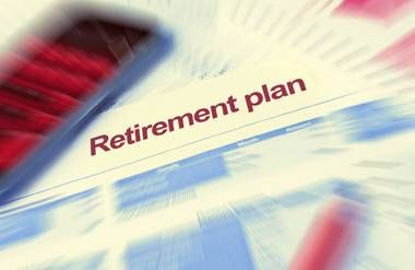 Retirement plan with blurred calculator, forms