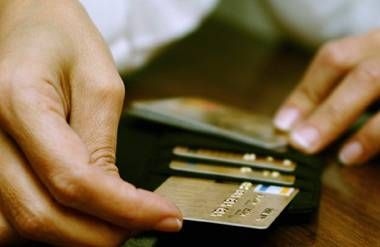 Woman taking credit card out of wallet