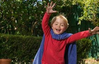 A child playing Superman