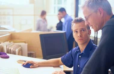 senior colleague mentoring younger colleague
