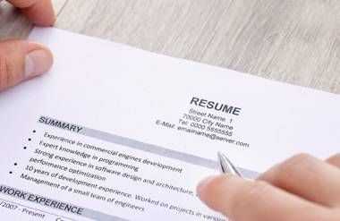 Person reviewing resume