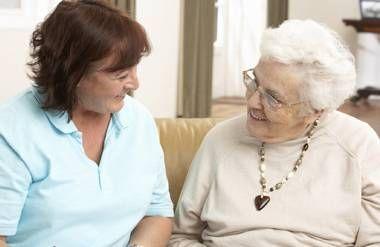 Older woman talking to caretaker