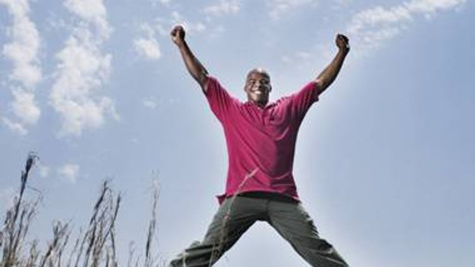 Man doing jumping jacks