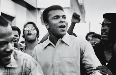 Muhammad Ali walks through the streets of NYC with members of the Black Panther