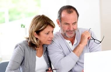 Couple looking at financial information on computer