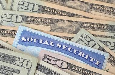 Social security card with cash money