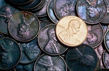 Shiny penny with tarnished pennies
