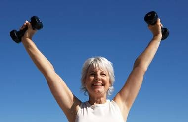 Energetic woman lifting weights