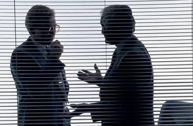 Silhouette of businessmen talking