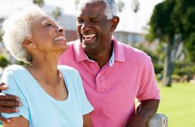 Retired couple laughing