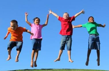 Group of kids jumping together