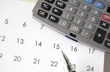Desk calendar, calculator, finances