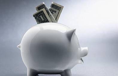 Piggy bank with a little money
