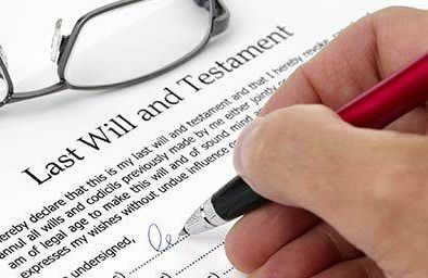Person working on their last will and testament