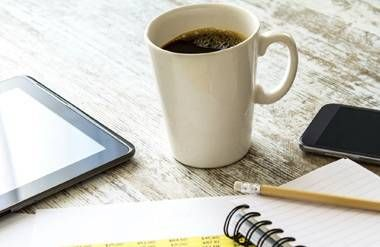 Notebook, pencil, numbers, coffee, phone and tablet