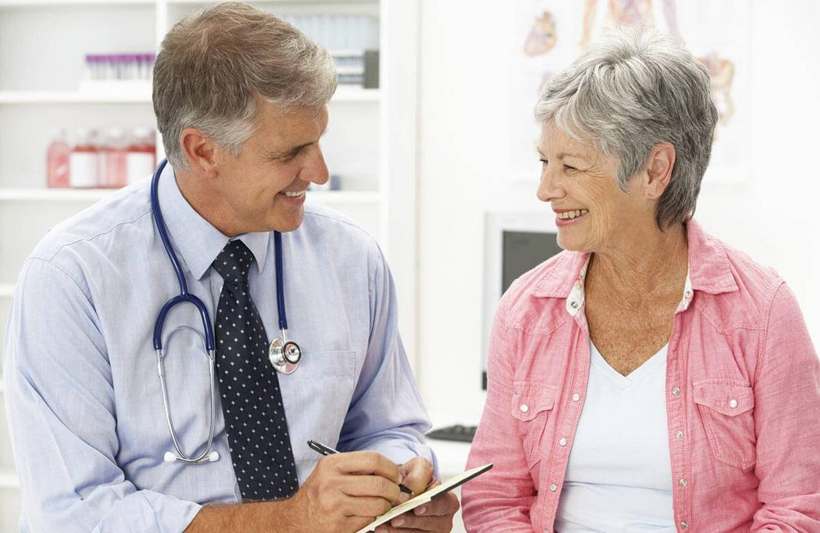 Woman talking with her doctor