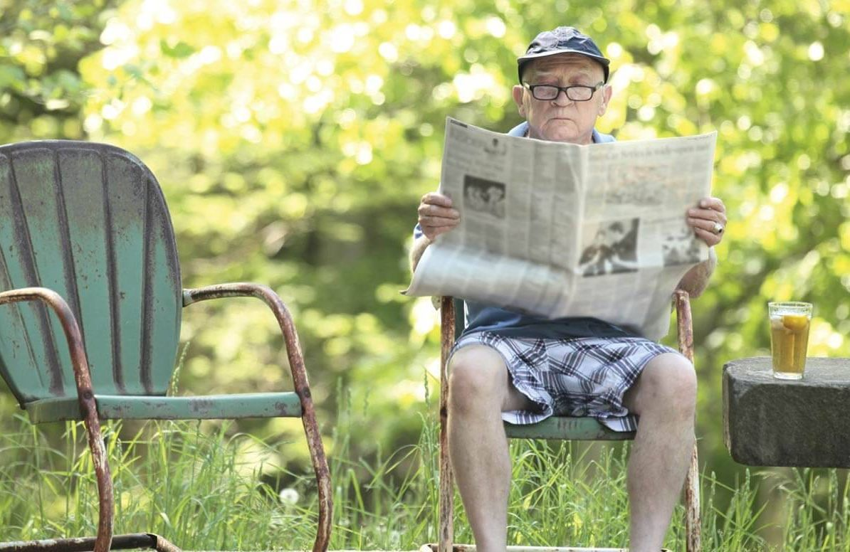 Retired man reading the paper