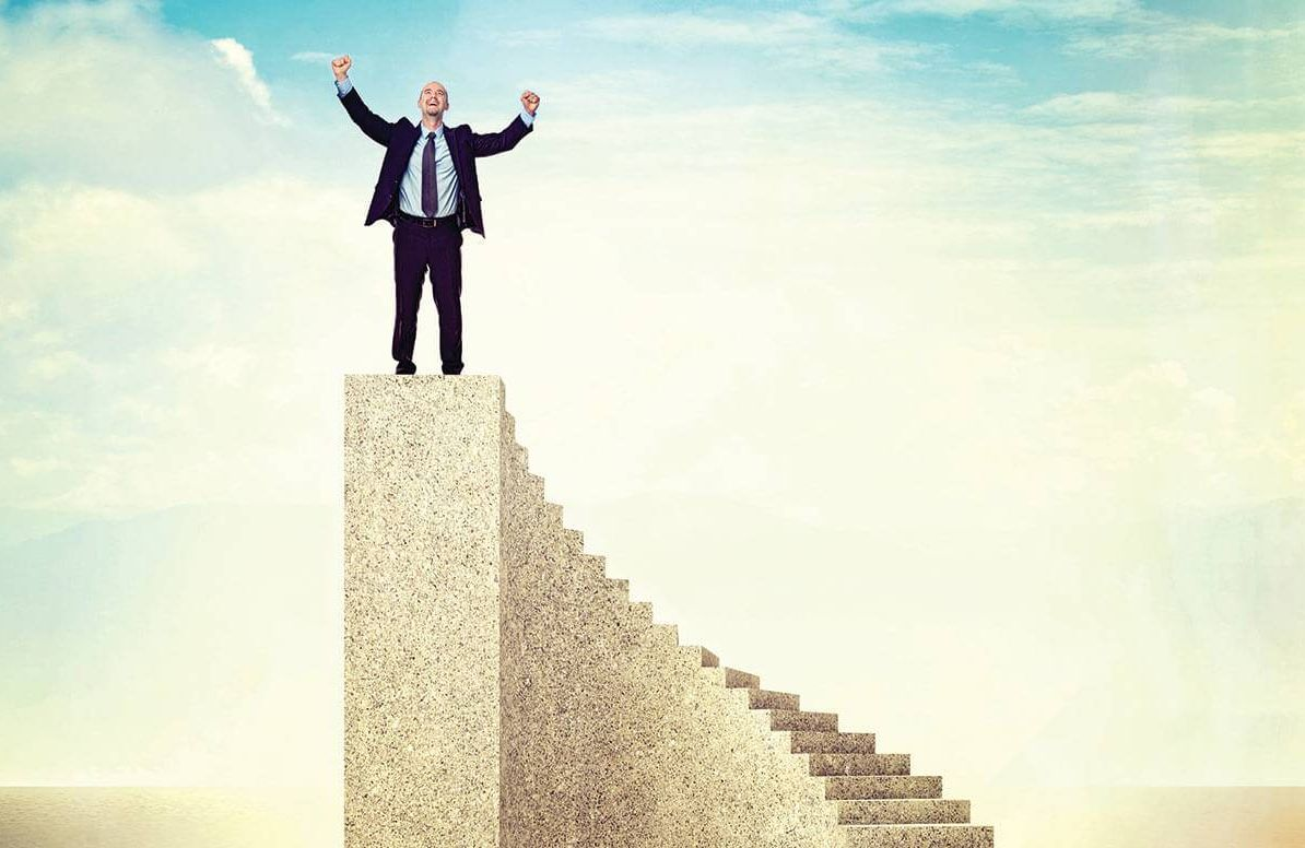 Illustration of man on top of stairs