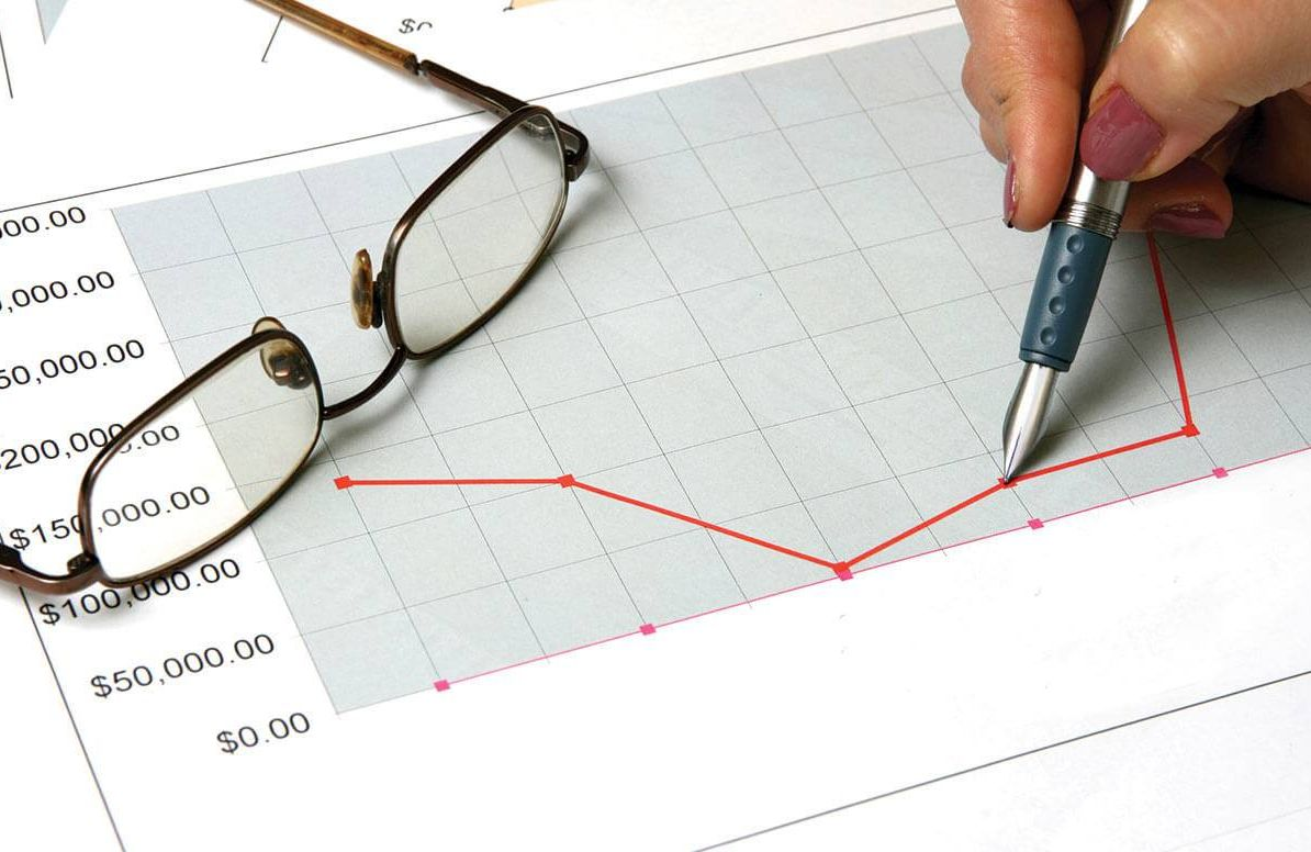 Person analyzing financial chart