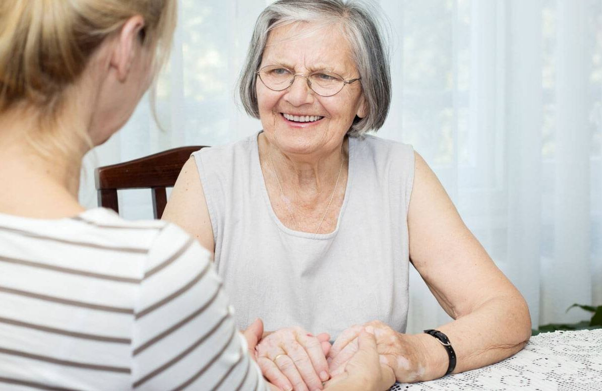 Elderly parent and daughter talking