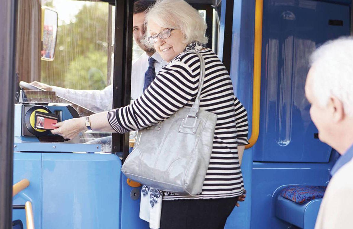 Woman boarding city bus
