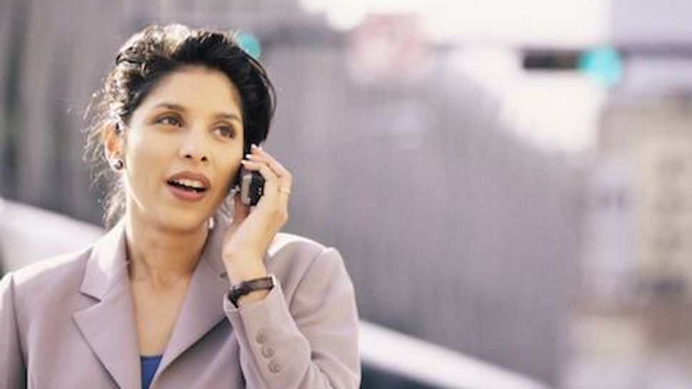 Businesswoman talking on a mobile phone smiling