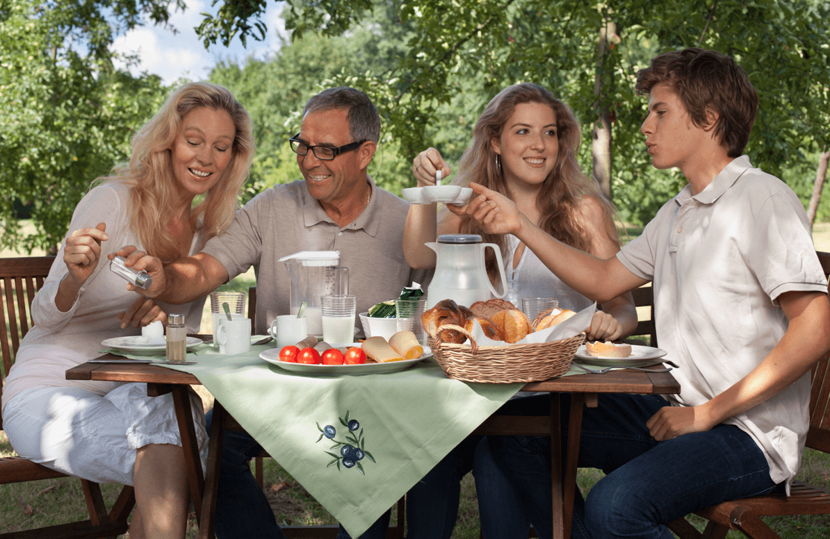 grown children and parents eating outside