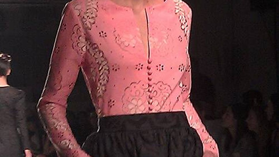 "Pink in shades from rosy to hot showed up in many show, including this top from Stella. It's the season's ""it"" color"