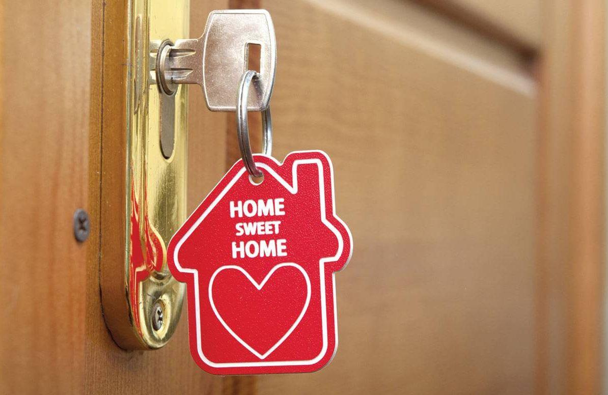 Home Sweet Home keychain key in door