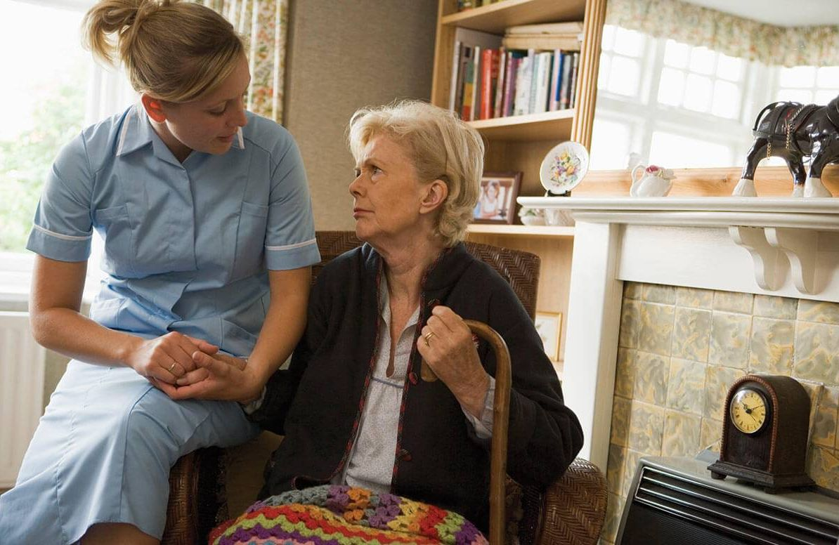 Woman with home healthcare worker
