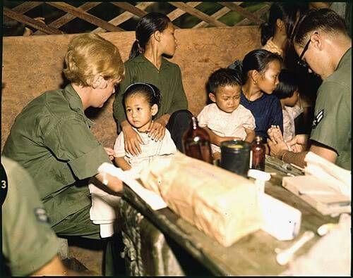Second Lt. Kathleen M. Sullivan treats a Vietnamese child during Operation MED CAP.