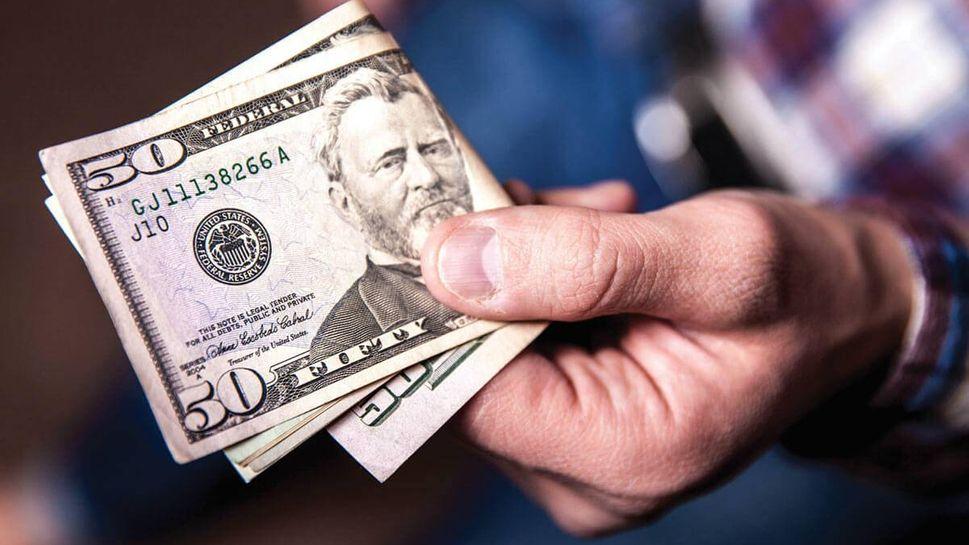 Retired man holding cash