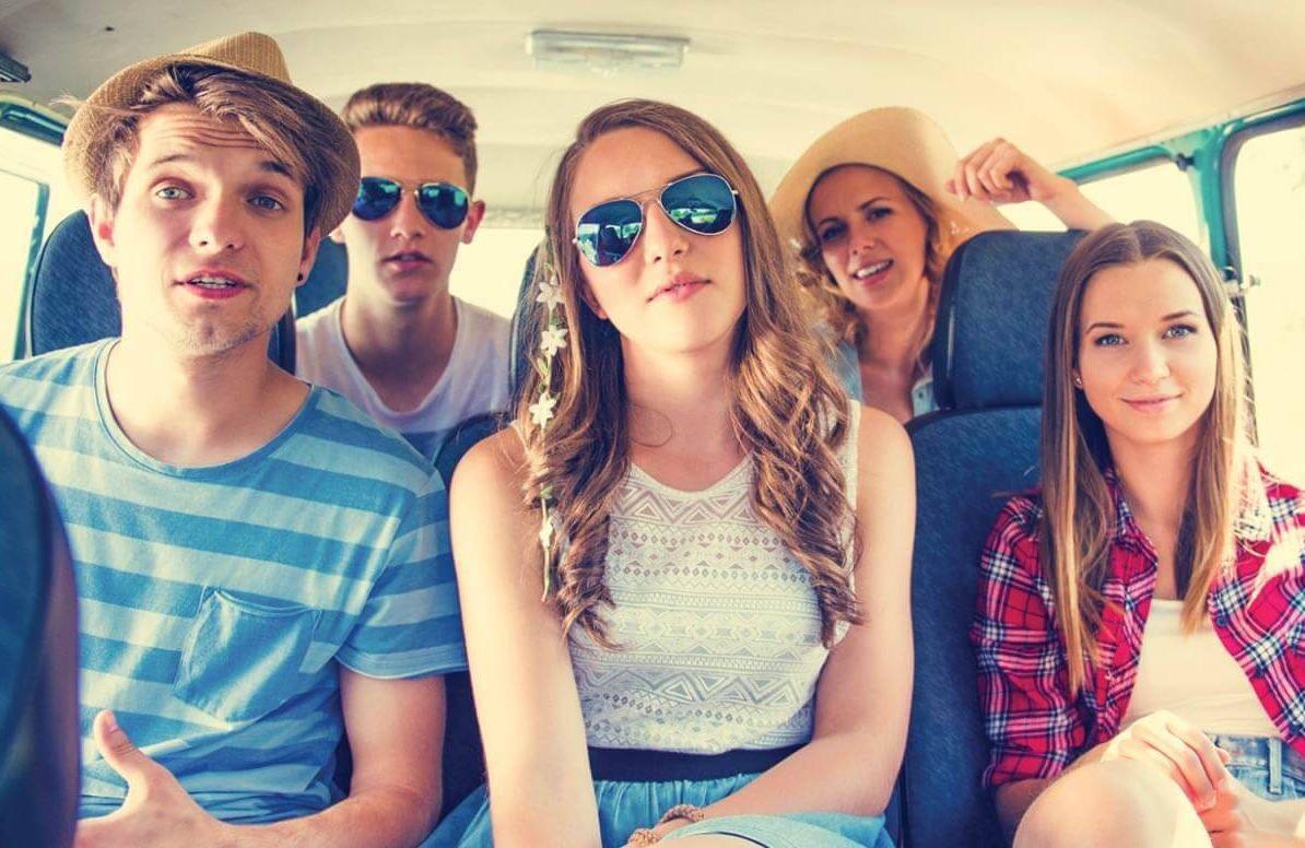 Millennial kids in a car