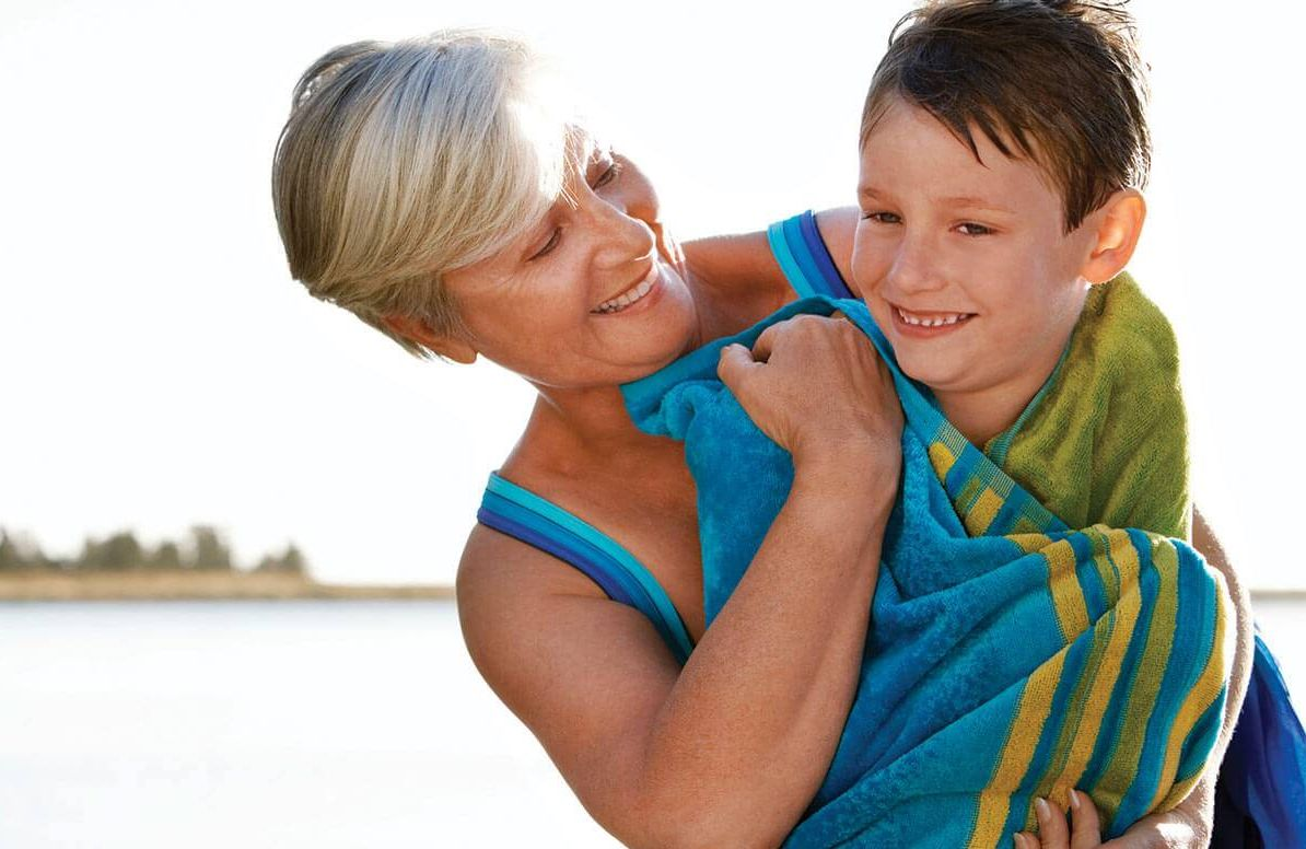 Grandmother vacationing with her grandson