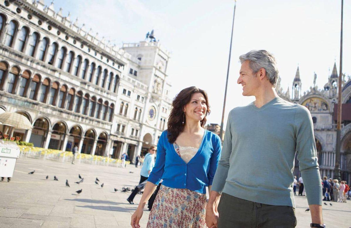 Couple walking through Venice