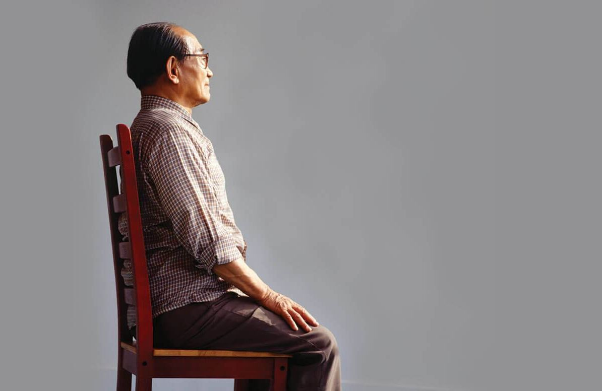 Man sitting straight in a chair